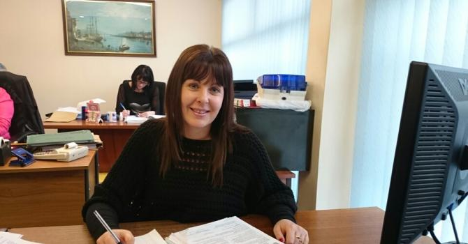 accountant sat at her desk devon